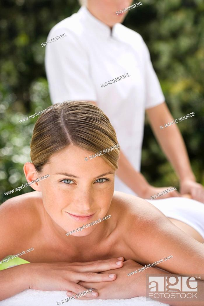 Stock Photo: Young woman receiving massage.