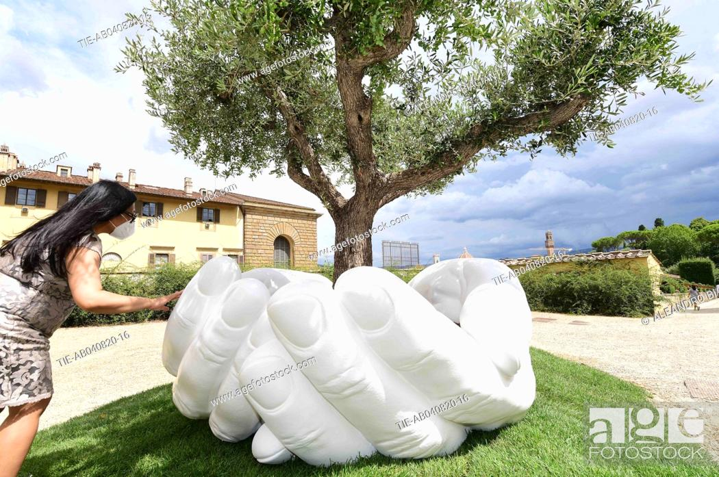 Stock Photo: The artwork ' Give ' by Lorenzo Quinn to the Boboli Gardens , Florence, ITALY-04-08-2020.