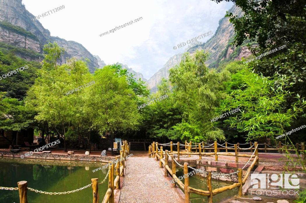 Stock Photo: Footbridge over a pond, Taihang Grand Canyon, Linzhou, Henan Province, China.