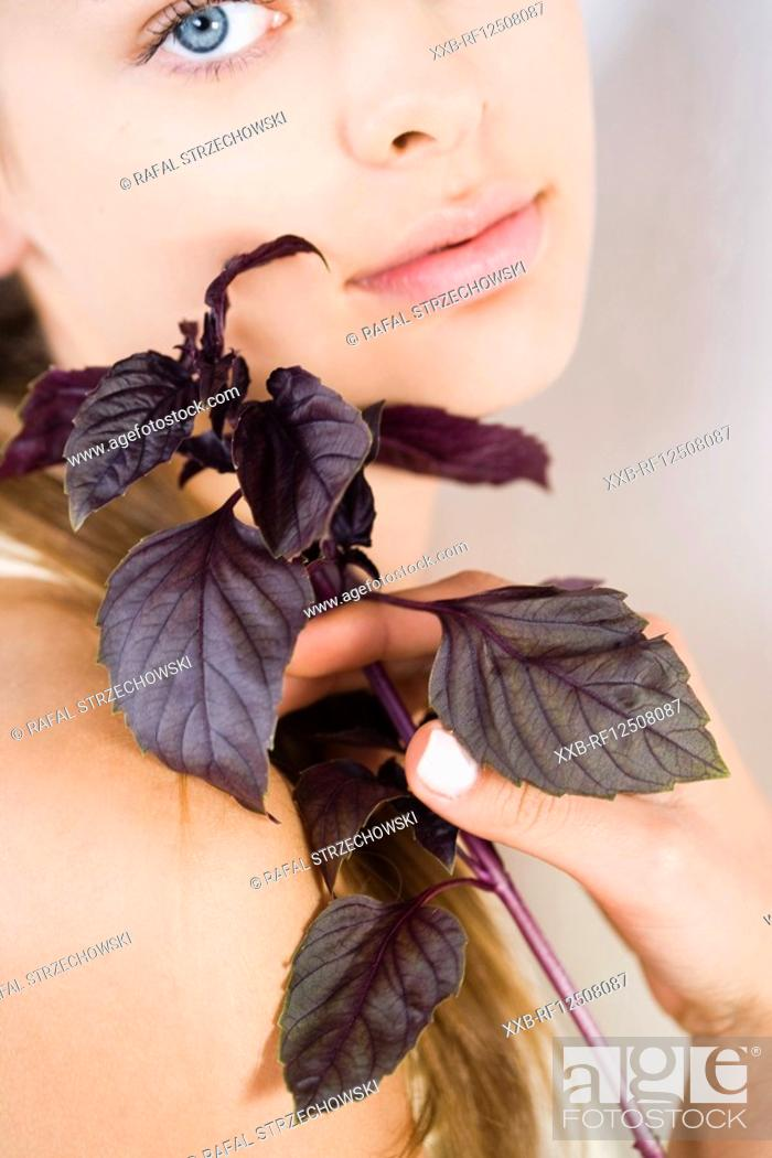Stock Photo: young woman with red basil.