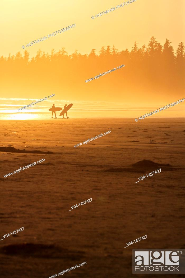 Stock Photo: Surfers on a beach, Vancouver Island, British Columbia, Canada.