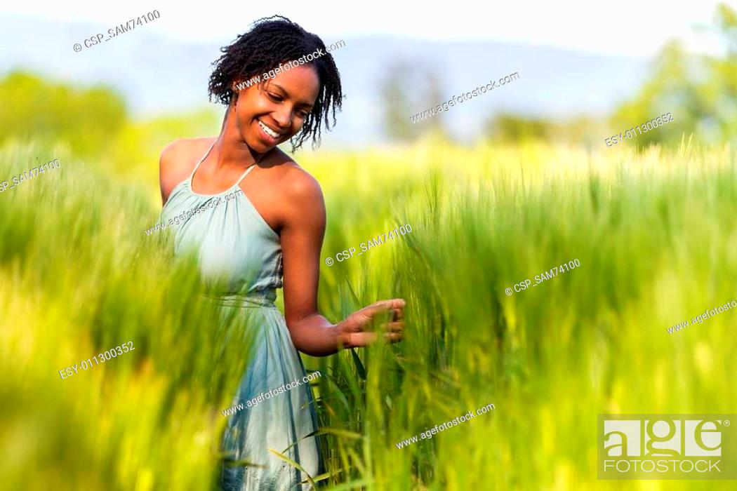 Stock Photo: African American woman in a wheat field - African people.