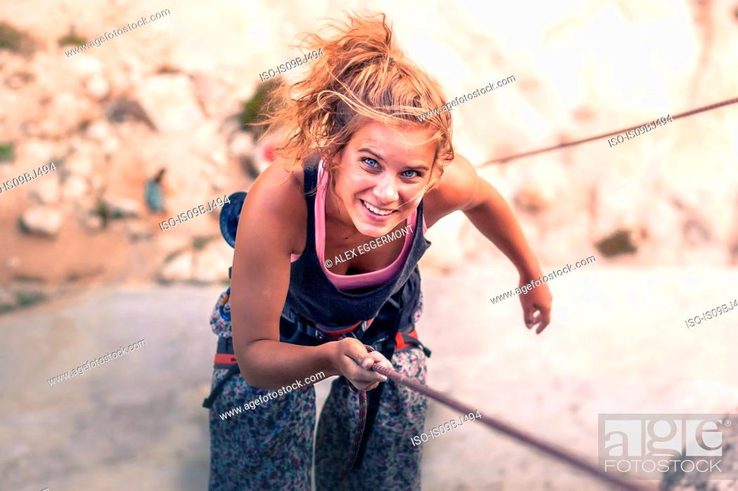 Stock Photo: Rock climber rock climbing, Yosemite National Park, United States.