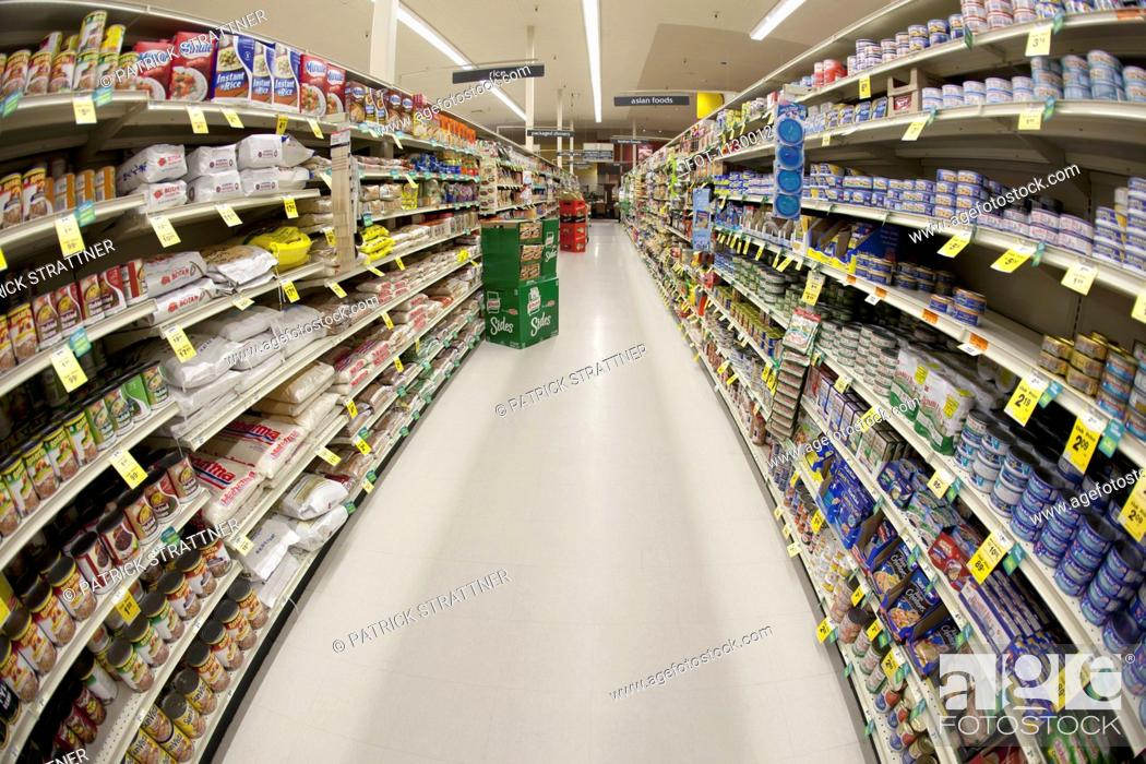 Stock Photo: An aisle of a grocery store, diminishing perspective.
