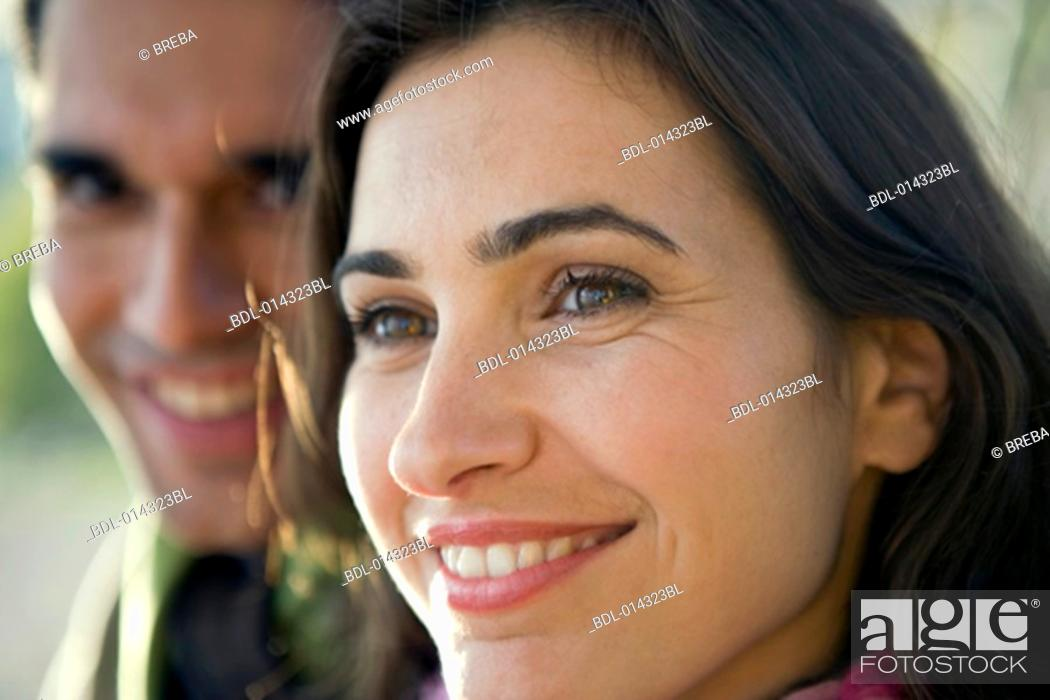 Stock Photo: close-up portrait of couple with woman smiling.