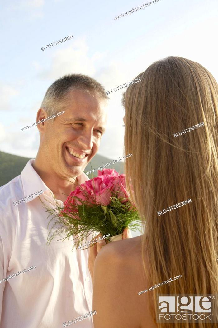 Stock Photo: Newlyweds looking at each other.