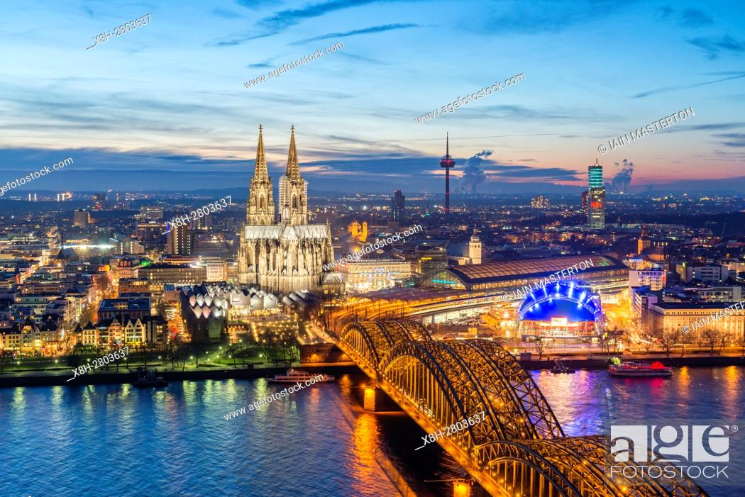 Stock Photo: Evening view of skyline of Cologne, Germany with floodlit Cathedral prominent.
