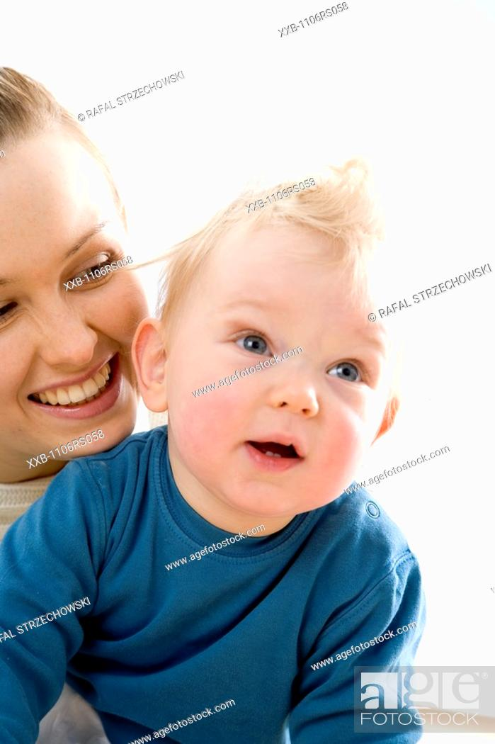Stock Photo: young mum with baby boy.