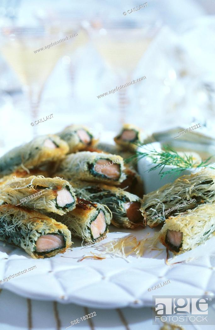 Stock Photo: Salmon rolls with Kadaïf and spinach.