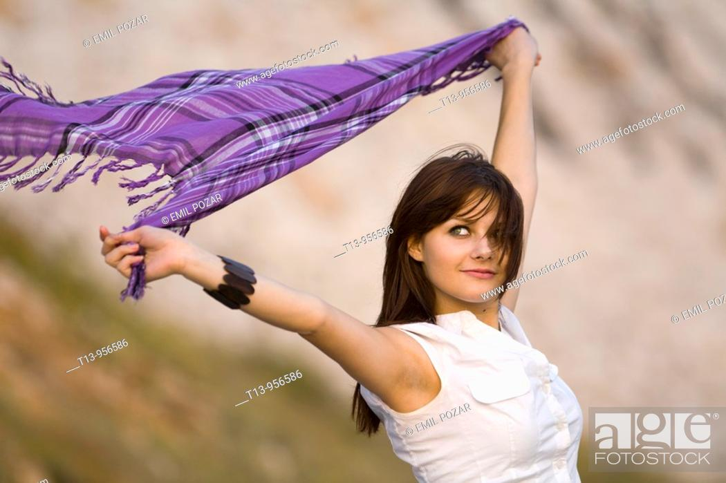 Stock Photo: Waving with scarf young woman.