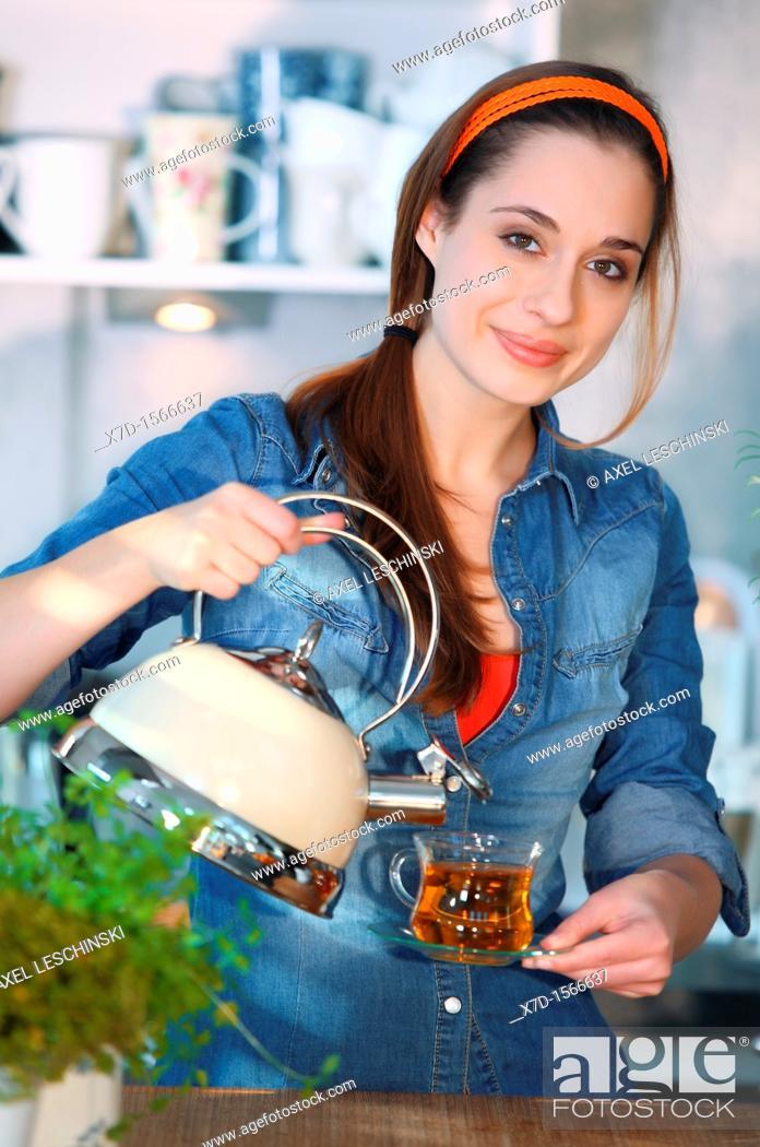 Stock Photo: woman drinking tea.