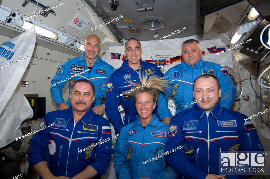 Stock Photo: Inside the Kibo laboratory of the Japan Aerospace Exploration Agency, the six Expedition 36 crew members position themselves for a videotaped tribute to.