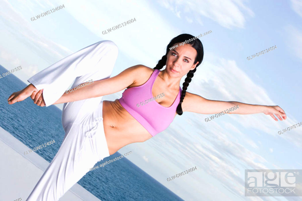 Stock Photo: Portrait of a young woman exercising.
