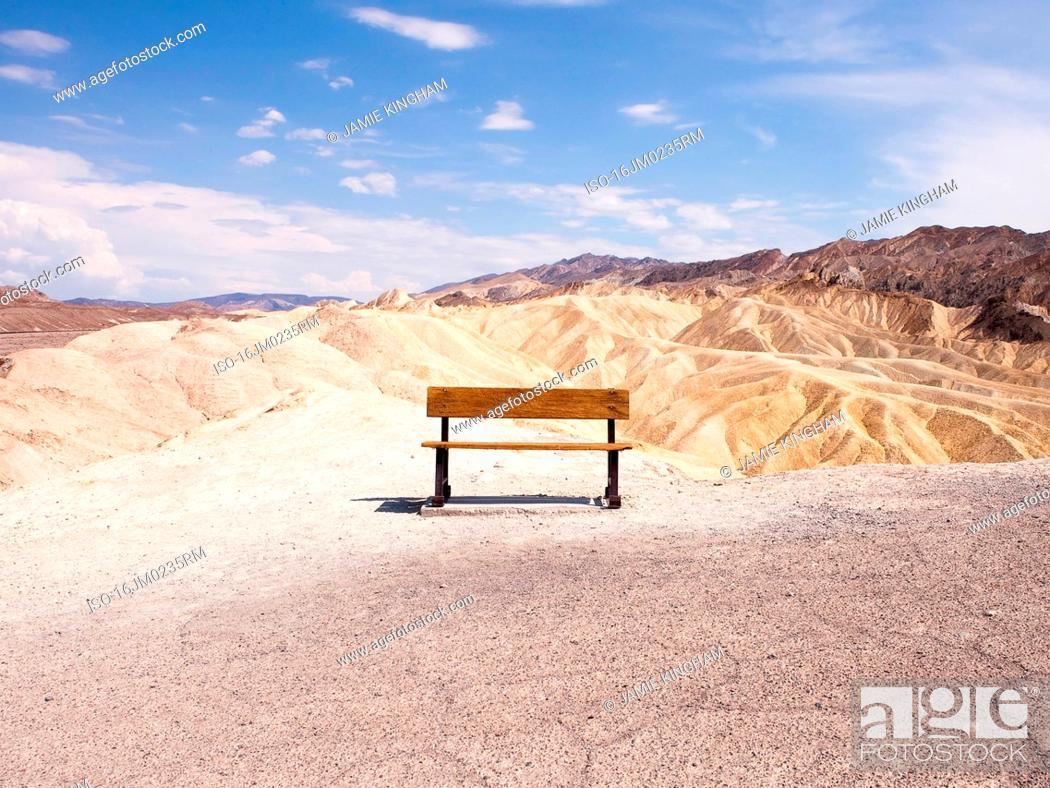 Stock Photo: Empty bench overlooking desert mountains.