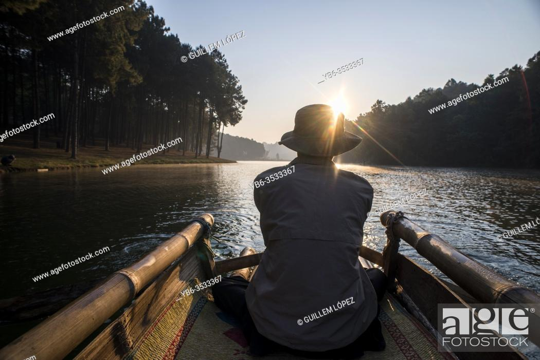 Stock Photo: Bamboo raft ride at sunrise at Pang Ung Lake, Mae Hong Son, Thailand.