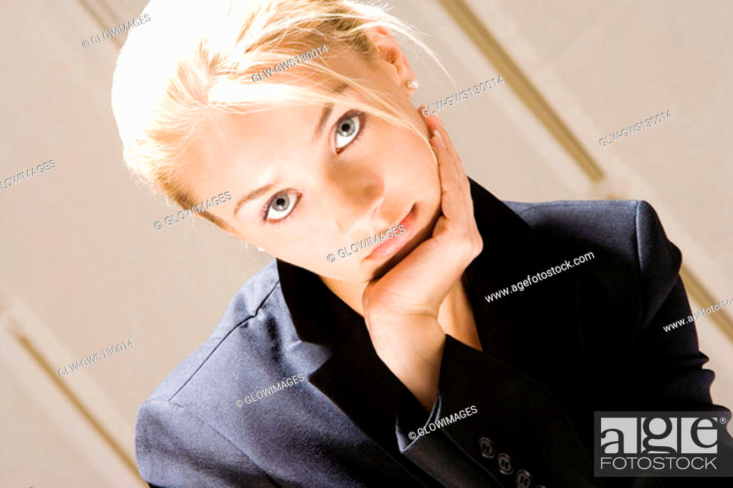 Stock Photo: Portrait of a young woman with her hand on her chin.