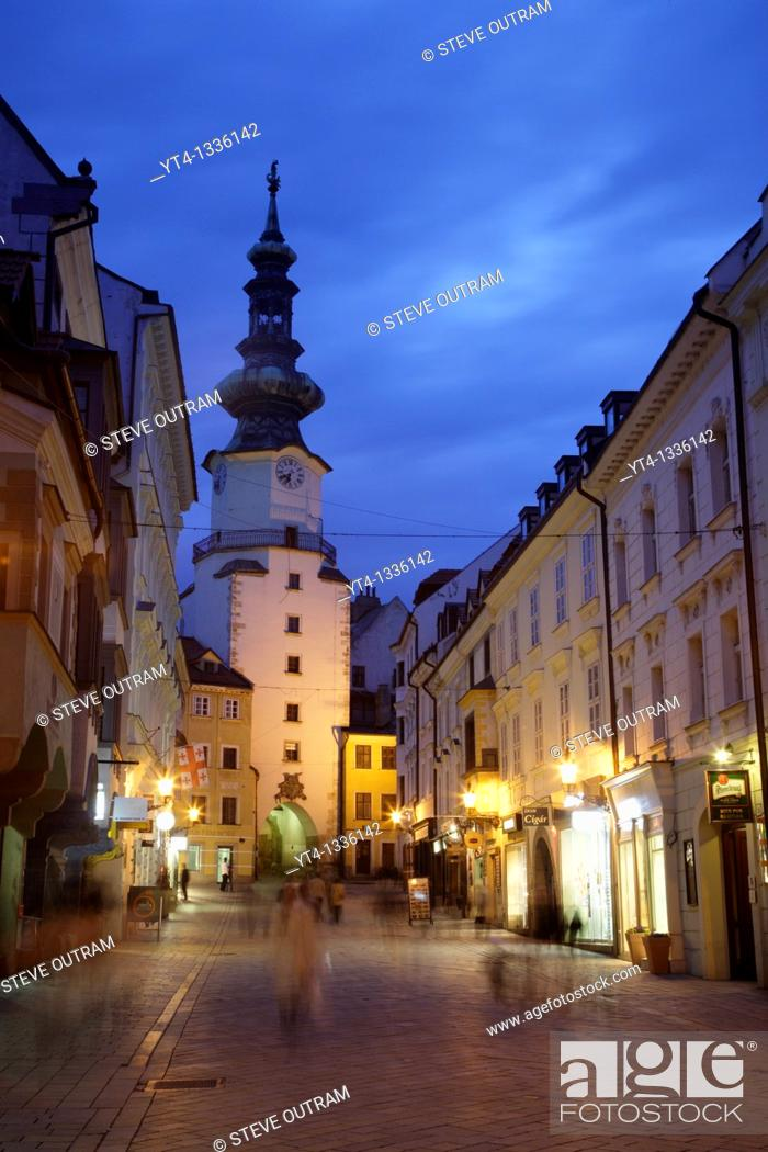 Stock Photo: Saint Michaels Tower illuminated at night, Bratislava, Slovakia  Built in the 13th century, it remains the only Gothic gateway remaining along the Old City.