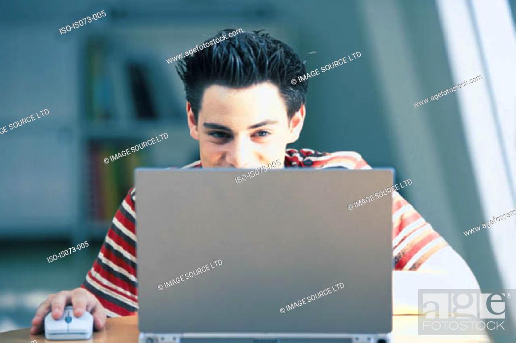 Stock Photo: Man at computer.