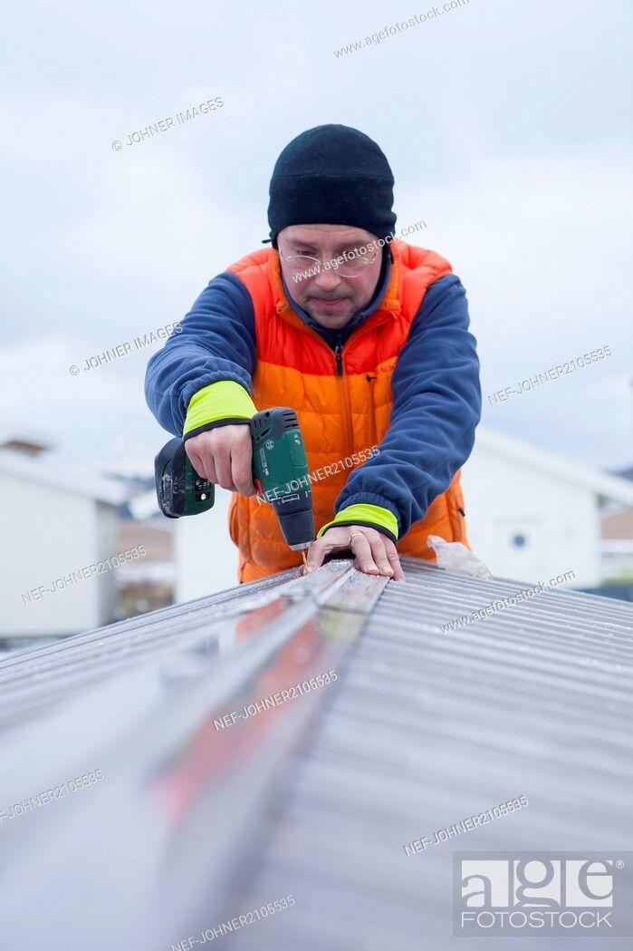 Stock Photo: Man repairing roof.