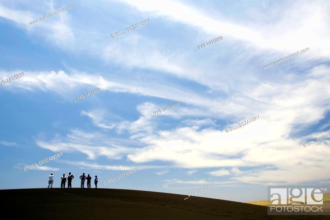 Stock Photo: Group of people on Shifting Sands dune, near Olduvai Gorge, Tanzania.