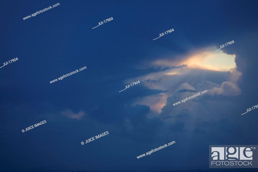 Stock Photo: Sunbeams in cloudy in sky.