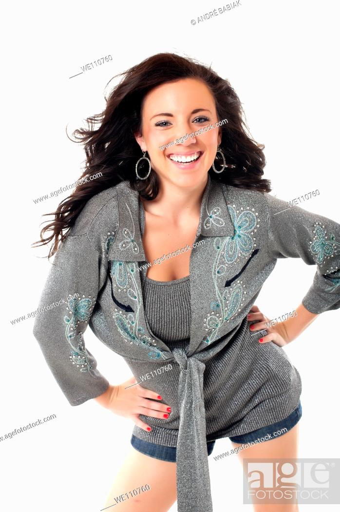 Stock Photo: Young woman in casual outfit posing and smiling.