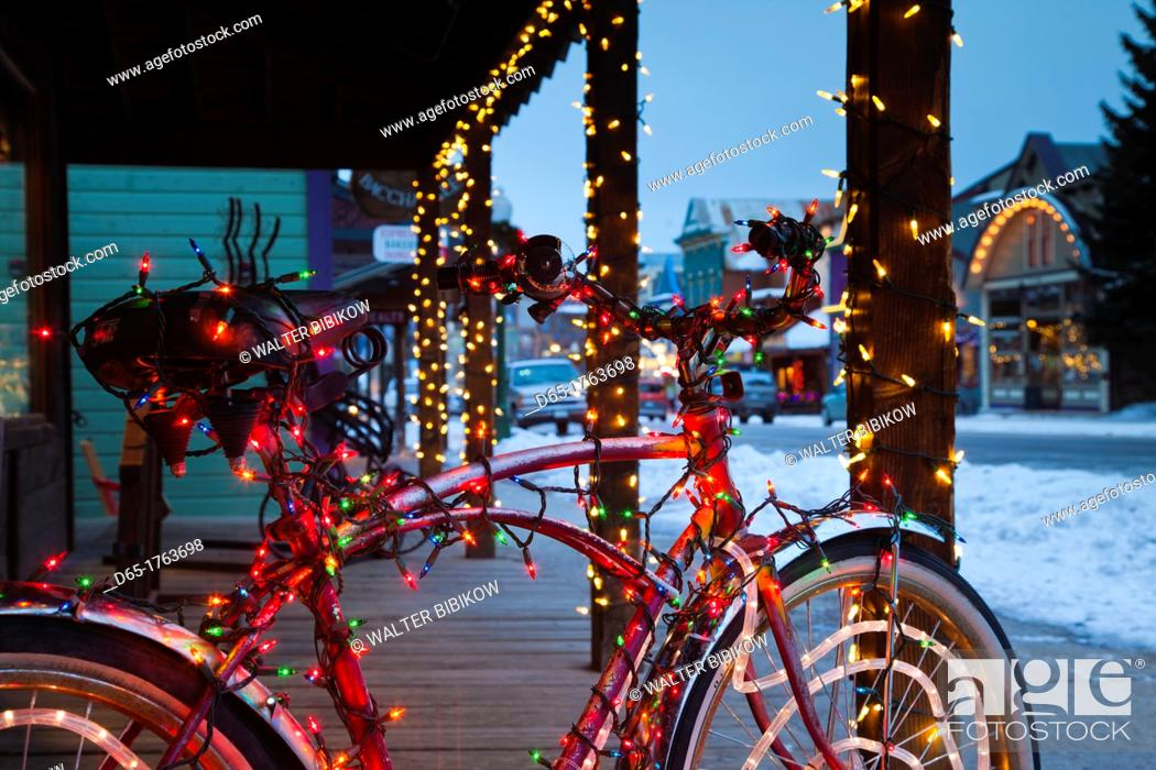 Stock Photo: USA, Colorado, Crested Butte, Elk Avenue, bicycle covered in colored lights.