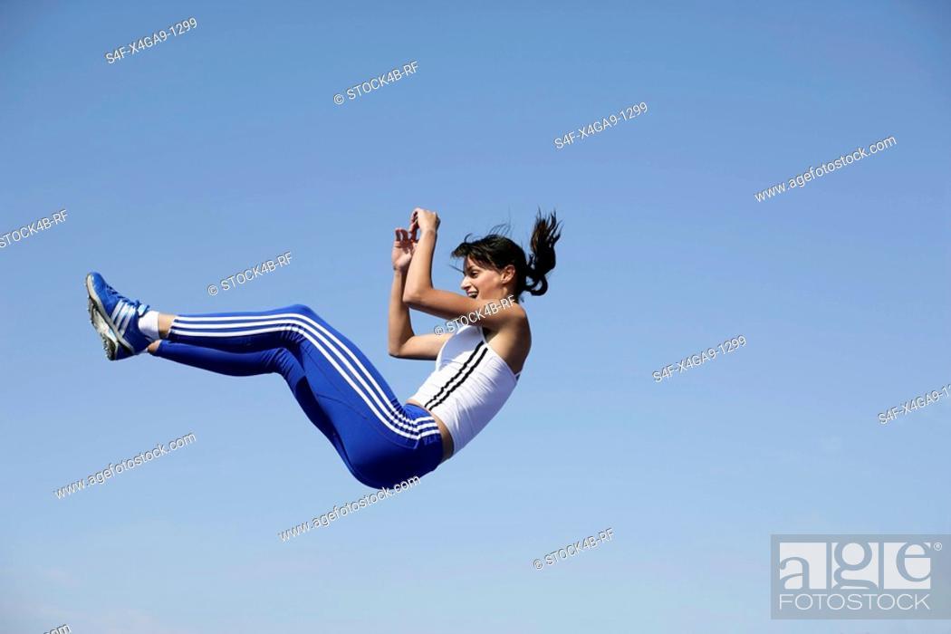 Stock Photo: Woman falling.