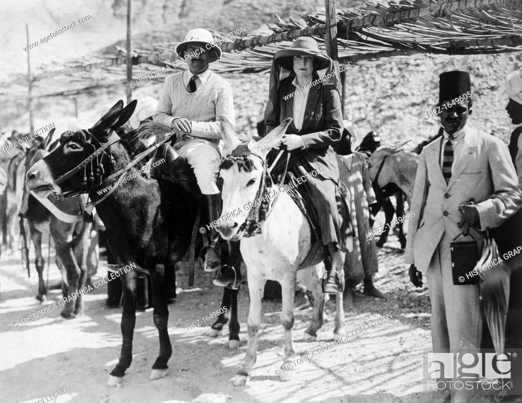 Stock Photo: Visitors to the Tomb of Tutankhamun, Valley of the Kings, Egypt, 1922. Lady Ribblesdale and Mr Stephen Vlasto arriving on donkeys.