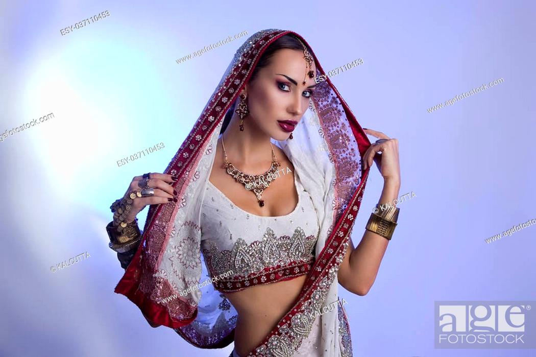 9ee343ed68 Stock Photo - Beautiful Young Indian Woman in Traditional Clothing with Bridal  Makeup and Oriental Jewelry. Beautiful Girl Bollywood dancer (Bellydancer)  in ...