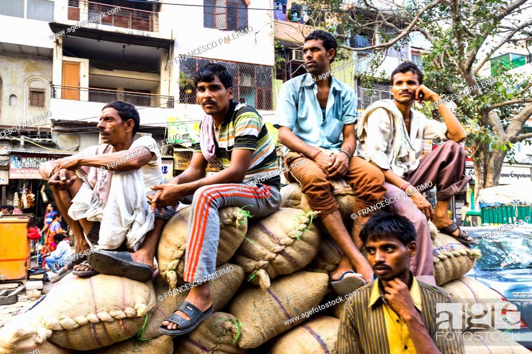 Stock Photo: Indian people in pose. New Delhi, Delhi. India.