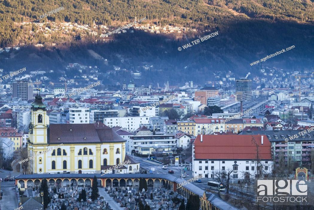 Stock Photo: Austria, Tyrol, Innsbruck, elevated view of the Wilten Basilica, dawn, winter.