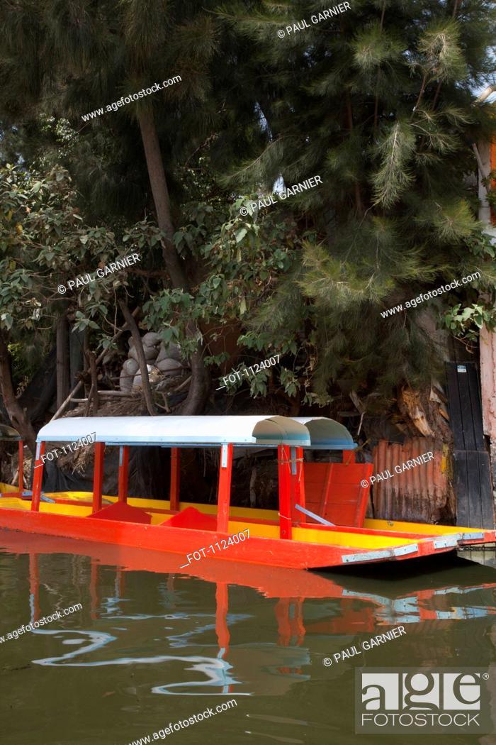 Stock Photo: Two Trajinera boats, a gondola type Mexican tour boat.