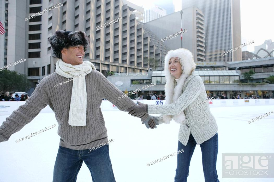 Stock Photo: Mature couple ice skating.