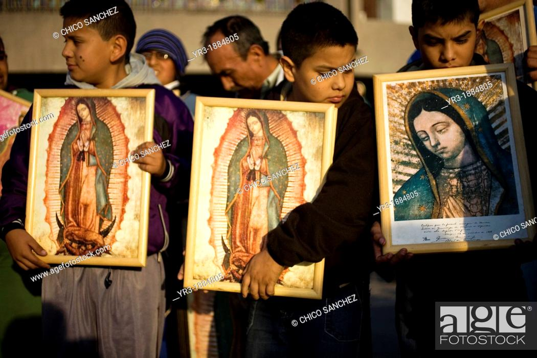 Stock Photo: Young pilgrims carry an image of the Our Lady of Guadalupe outside of the Our Lady of Guadalupe Basilica in Mexico City, December 9, 2012.
