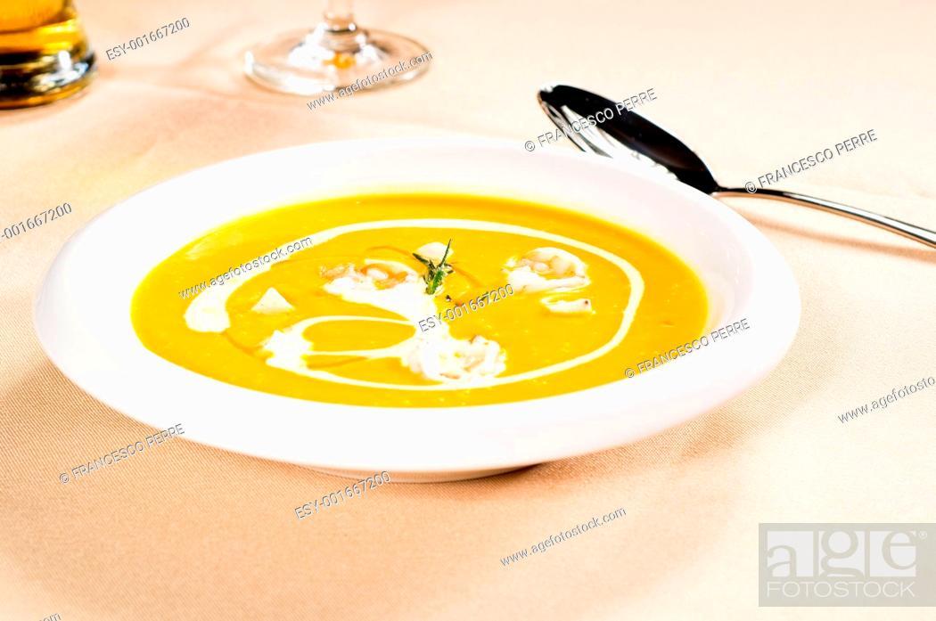 Stock Photo: pumpkin and shrimps cream soup.