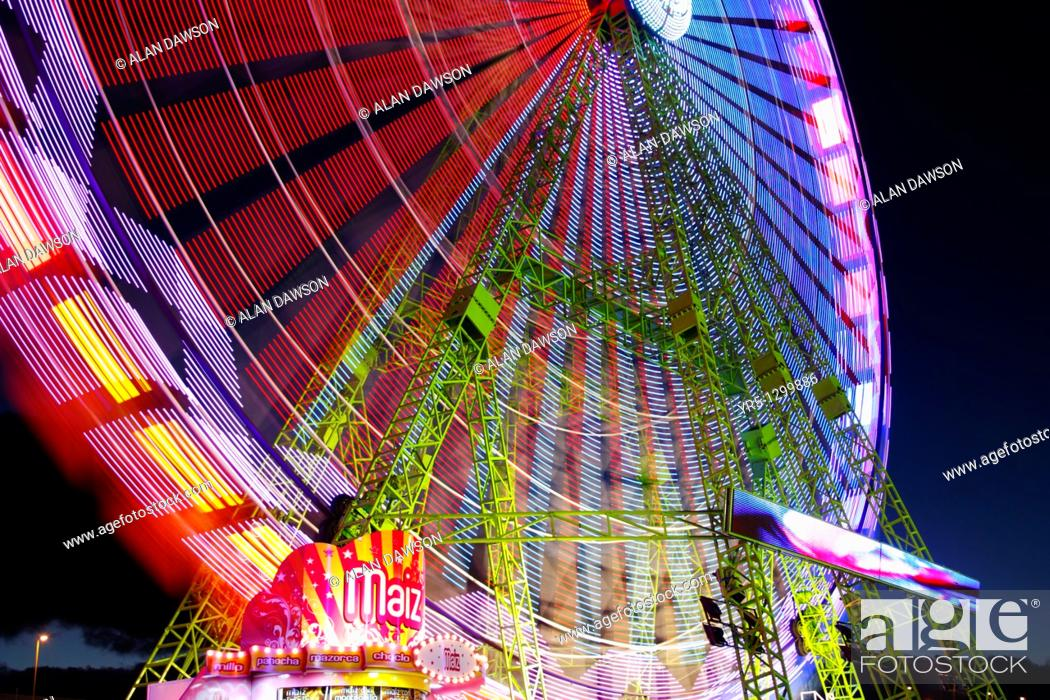 Stock Photo: Popcorn stall and big wheel at christmas fair on Gran Canaria, Canary Islands, Spain.