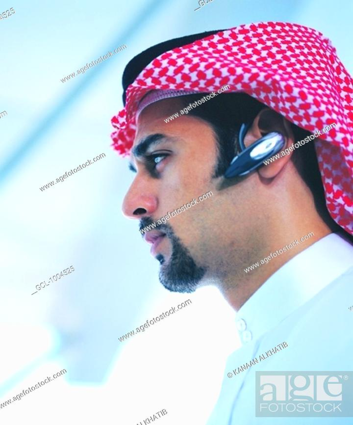 Stock Photo: Arab businessman with Bluetooth headset.