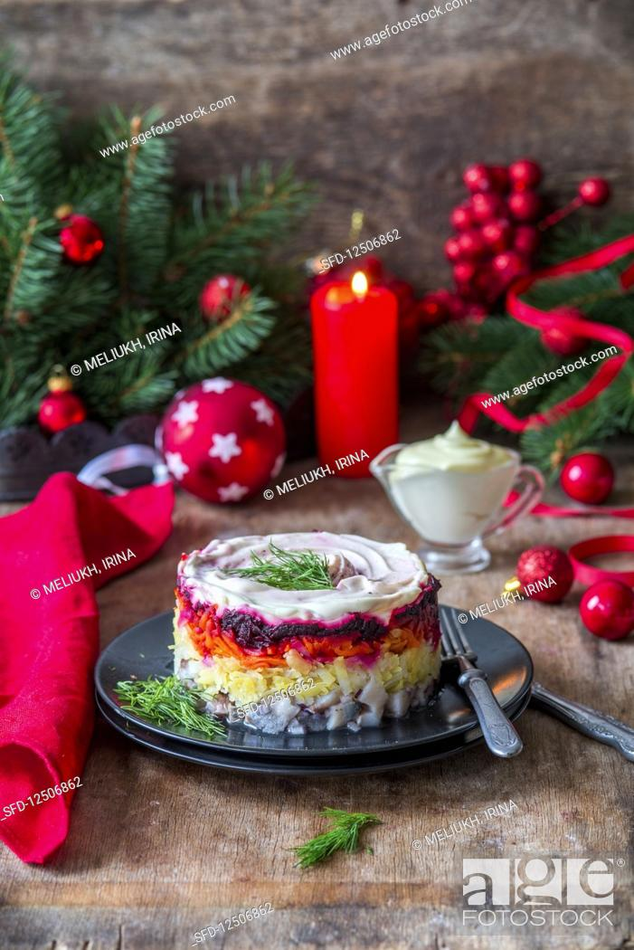 Stock Photo: Russian Shuba salad with herring, potato, carrots, beetroot and sour cream.
