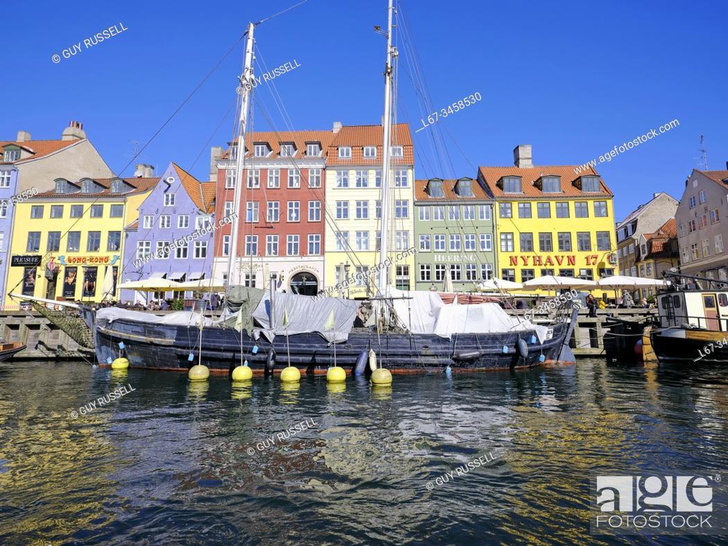 Stock Photo: Working boats at dock during summer in Nyhavn, Copenhagen.