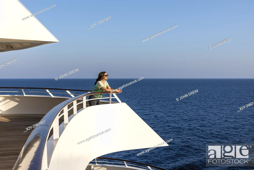 Stock Photo: Woman enjoys the ocean view from a yacht deck.