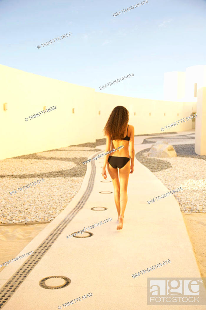 Stock Photo: Woman in bathing suit outdoors at resort hotel, Los Cabos, Mexico.