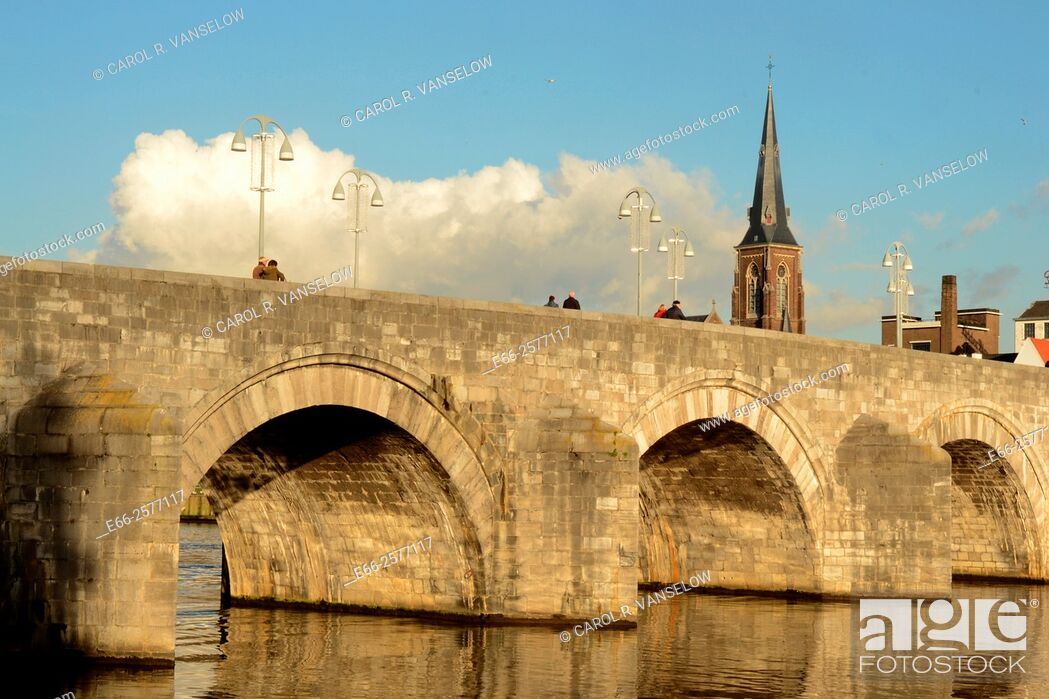 Stock Photo: Sint Servatius bridge on the Maas River in Maastricht. St Martins church in background.
