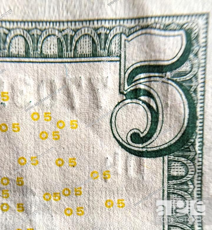 Stock Photo: Closeup of the corner of an American $5 bill.