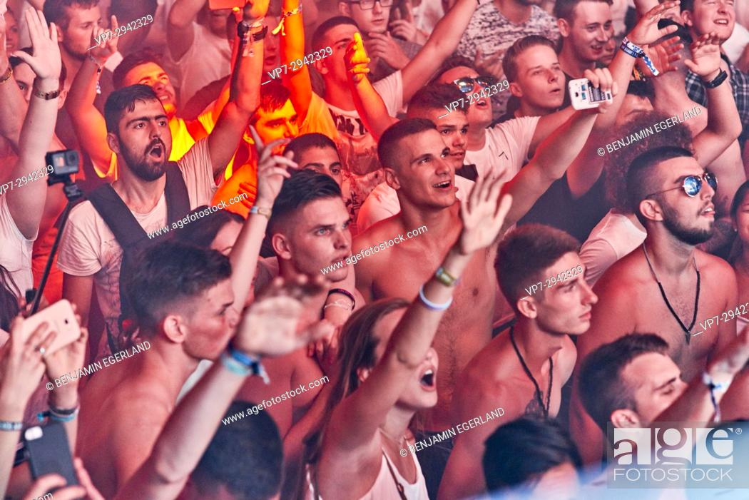 Stock Photo: party people cheering to Hardwell B2B Afrojack, enjoying edm dance music at music festival Starbeach, beach flirt dress in white party, on 17.