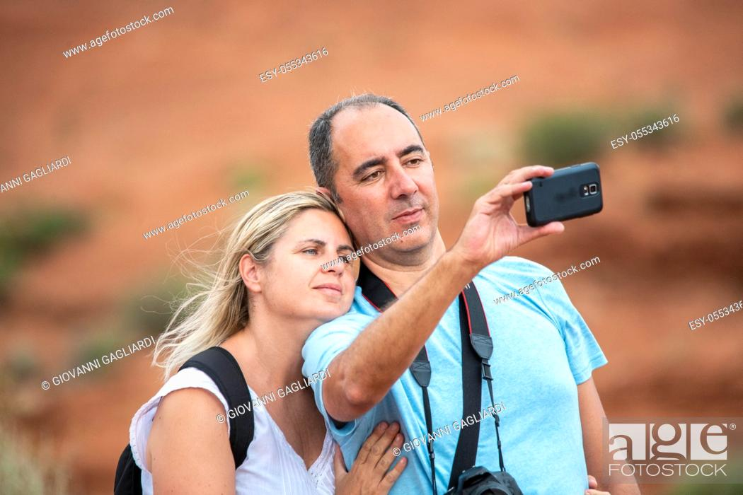 Stock Photo: Happy couple taking selfie in the national park.