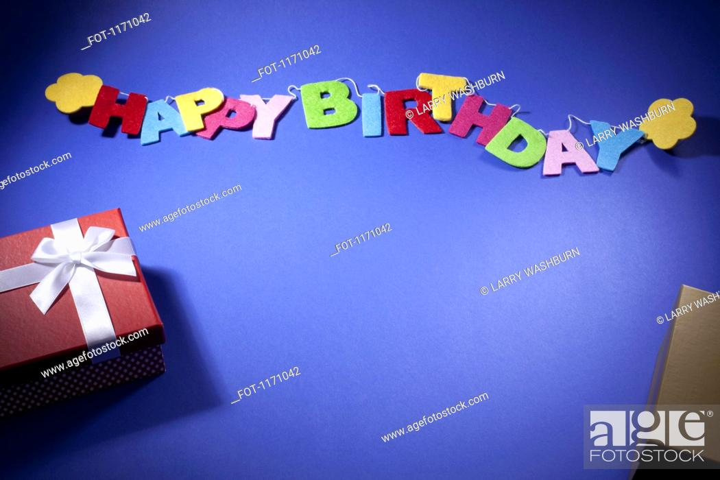 Stock Photo: Birthday gifts and a banner reading Happy Birthday.
