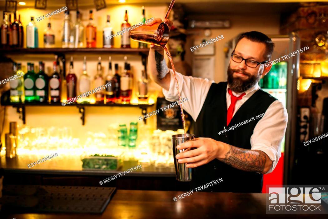 Stock Photo: Barkeeper show behind restaurant bar counter. Handsome alcohol beverage preparation.