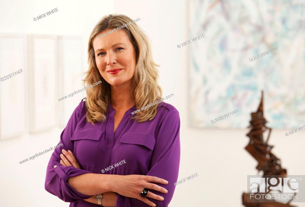 Imagen: Portrait of mid adult gallery owner.