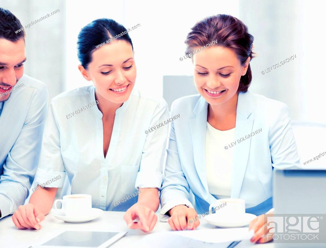 Stock Photo: friendly business team having discussion in office.